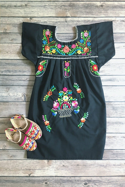 ShopMucho little girls Mexican dress embroidered with colorful flowers in black flatlay