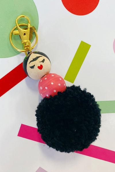 ShopMucho supports small businesses Frida painted pom charm by Jesi Lee