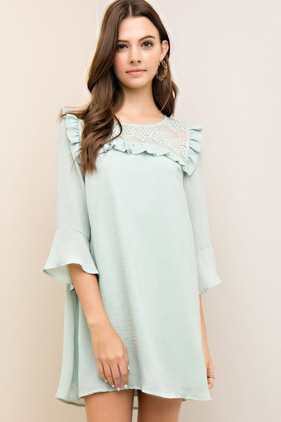 Solid crinkled A-line dress featuring crochet yoke with ruffles.