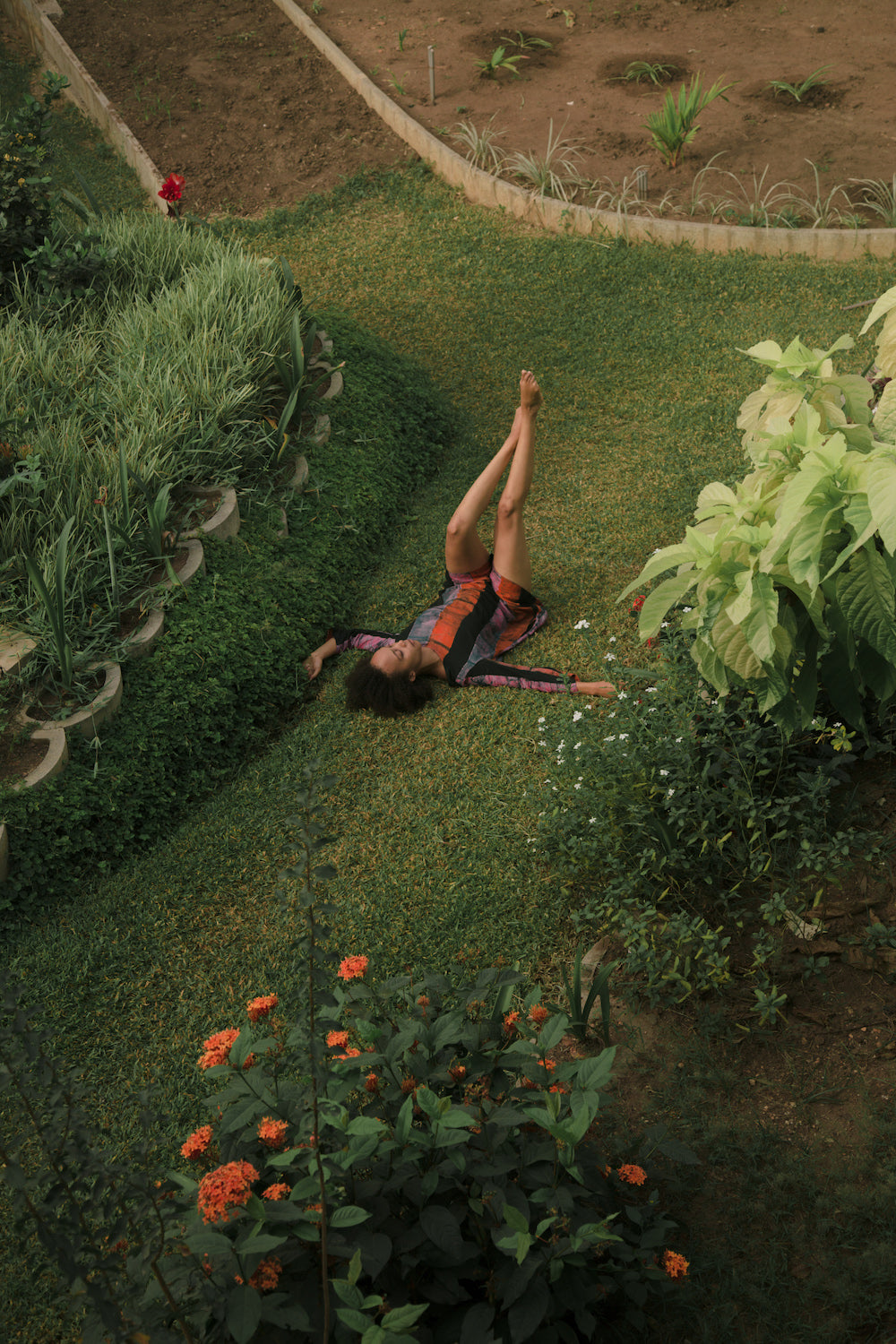 Efua Sutherland laying in the grass