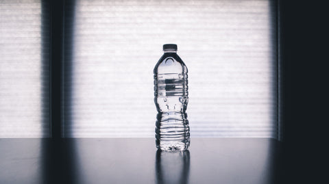 Plastic water bottle sits on a table