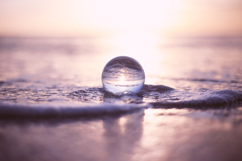 Drop of water on the beach
