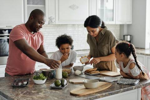 Family eating food at kitchen island