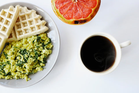 Assorted breakfast foods on a white table