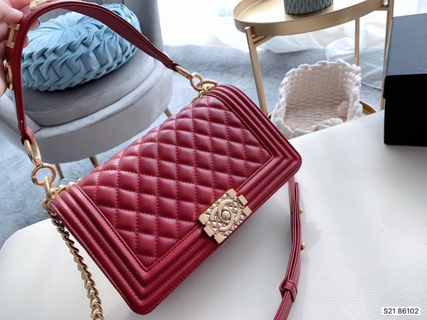 Le Boy Chanel flap bag with handle