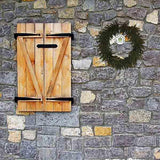 Wreef™ brand wreath on stone wall