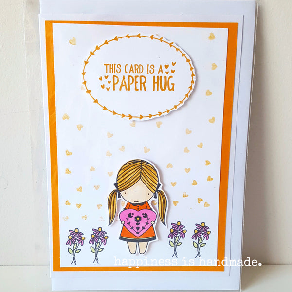 """This Card is a Paper Hug"" Young girl holding purple flowers on an orange background handmade greeting card"