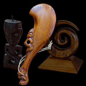Wooden Maori weapons and sculptures