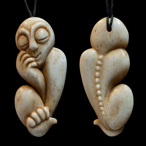 Carved bone figurine pendant by New Zealand Artist Yuri Terenyi