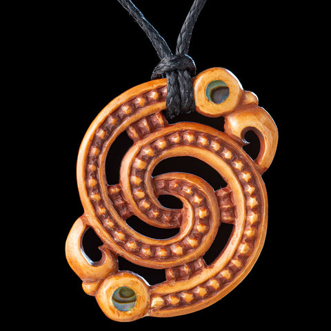 Stained Bone Maori Koropepe Pendant by Yuri Terenyi