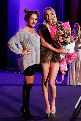 Cara representing Trick Fitness winning the amateur division with the beautiful judge Summer Blazin