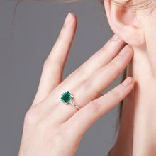 "Load image into Gallery viewer, GEMODA GEMODA ""Parisian"" 1 Carat Green Emerald Moissanite Ring in 925 Sterling Silver - Gemorie"