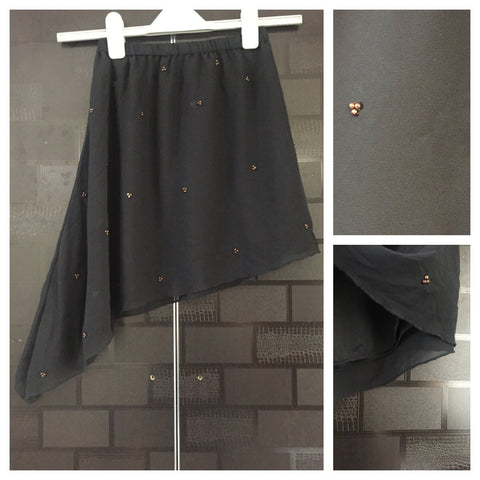 The Asymmetric Black Skirt with little bronze sequins