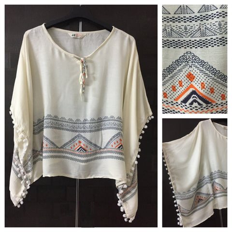 Printed Poncho Style Top - Triangle Story in Cream with White Pom-Poms