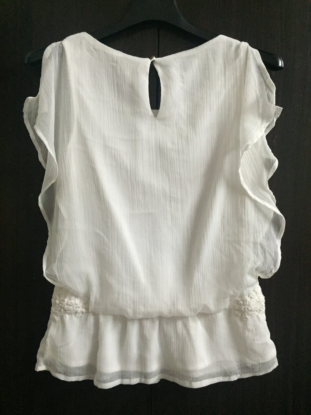 Pretty White Sleeveless Top with flowers on sides