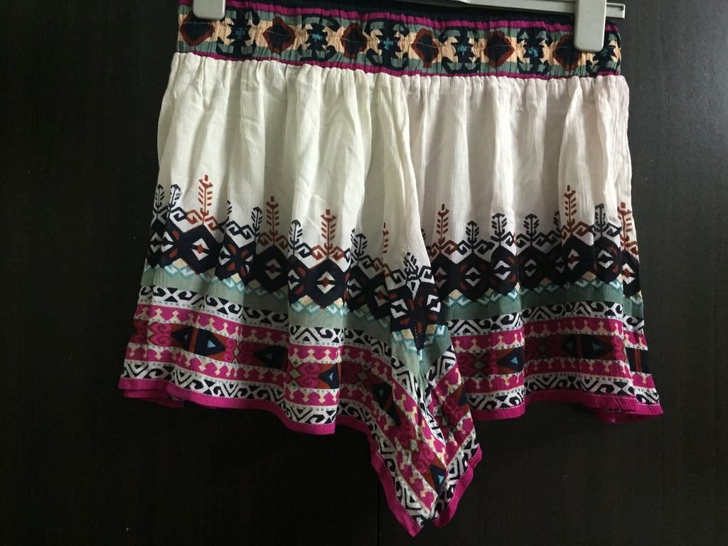 Cream Shorts with multicolor print design