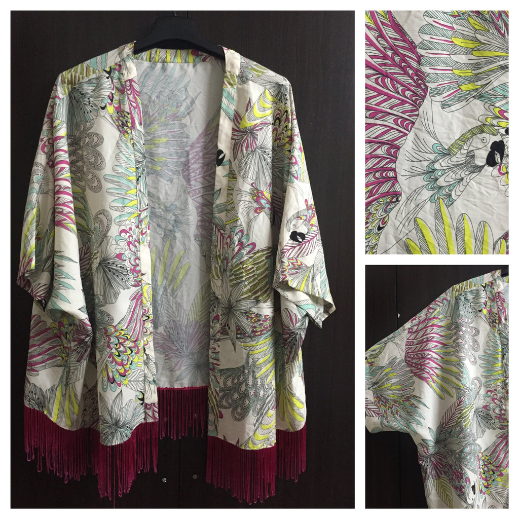 The Parrot Shrug with Pink Tassels