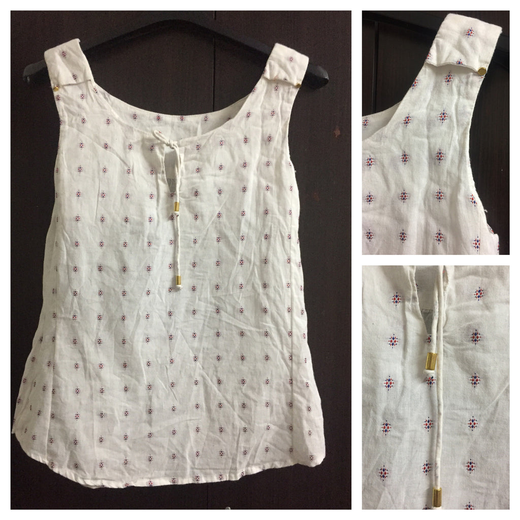 White Sleeveless Top with Red and Blue Thread work