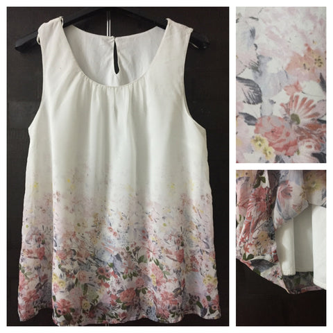 Pretty White Sleeveless Top with beautiful floral print on waist