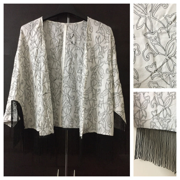 Black thread-work on cream Shrug with tassels on sleeves and waist - #FTFY - For The Fun Years