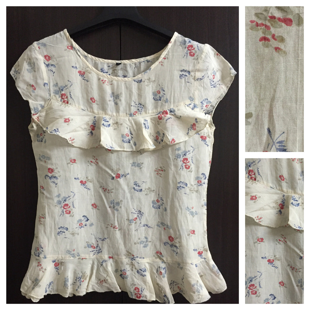 Pretty Cream Floral Top with short sleeves.