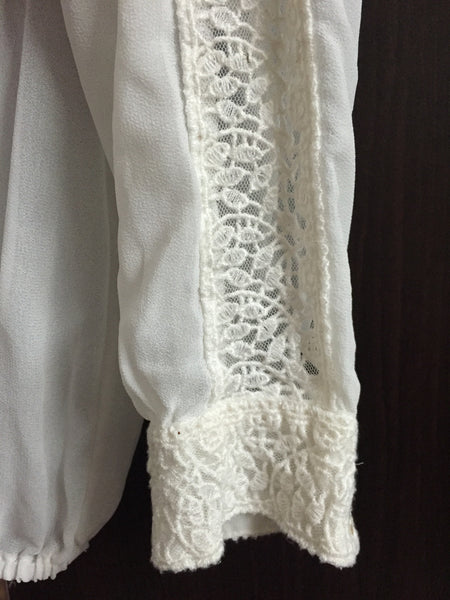 Elegant white top with lace work