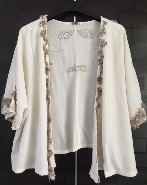 Cream Short Sleeved Shrug with Stylish Feather Like Patterned Back