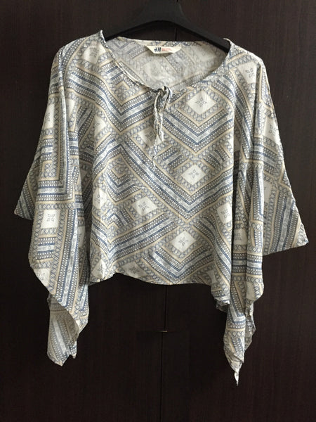 Poncho Style Cream Top with blue geometric print