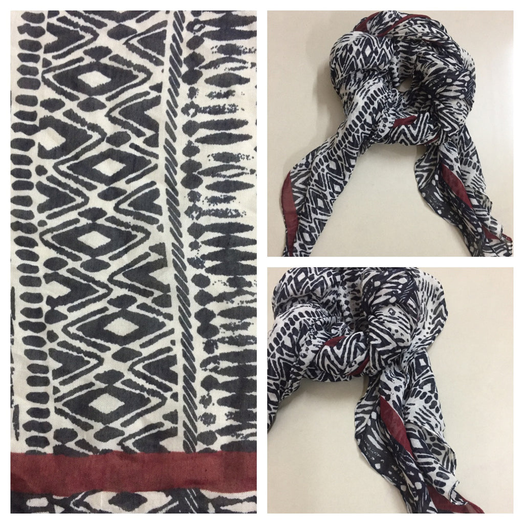 Rectangular Black and White Printed Scarf with Red stripe on 2 sides.