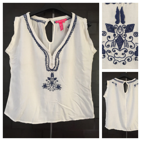 Pretty White sleeveless Top with Dark Blue thread embroidery