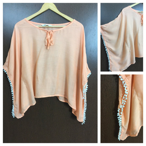 Poncho Style Top - Orange with White Pom-Poms.