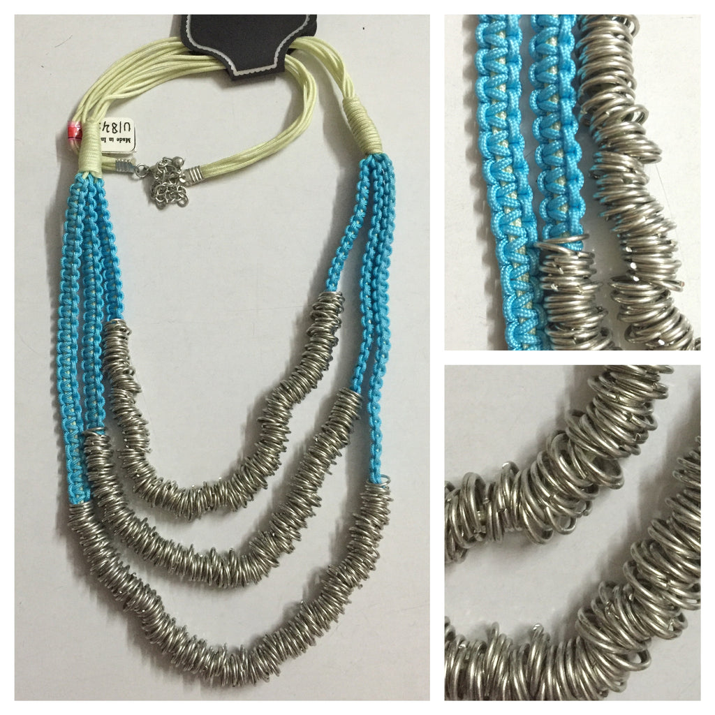 Silver Rings on Blue Neckpiece