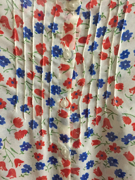 Red and Blue Flowers on White Top