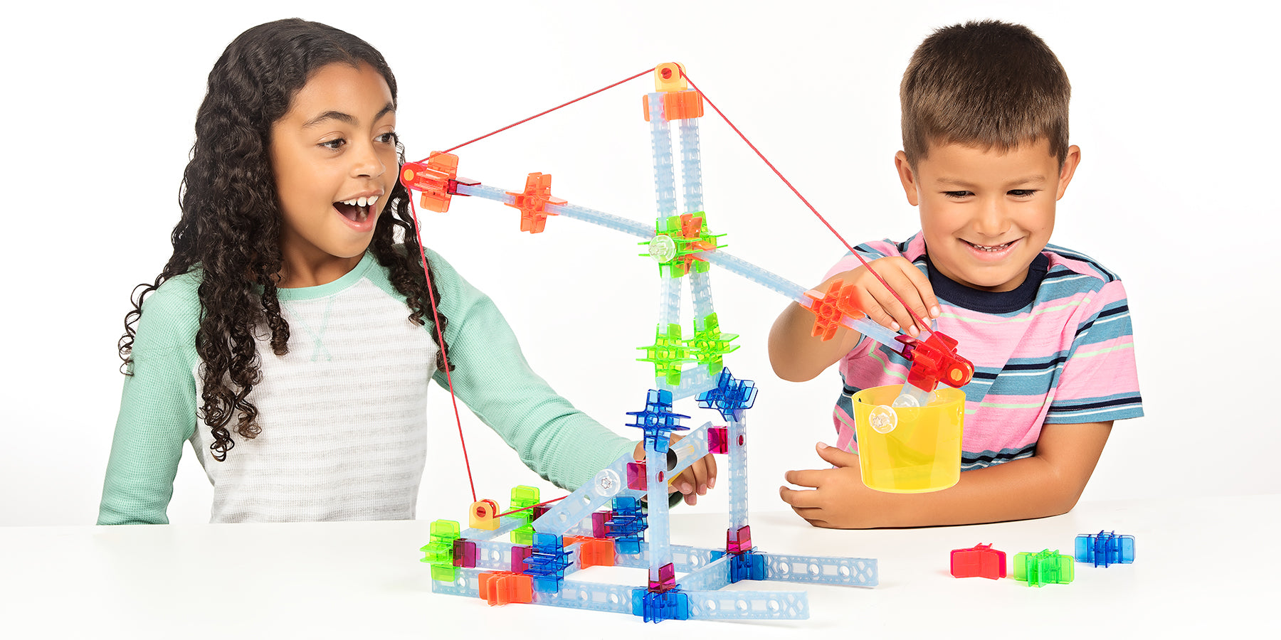 two children playing with brackitz pulleys