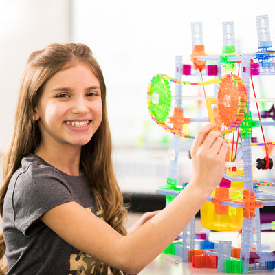 Girl playing with Brackitz learning center gears set