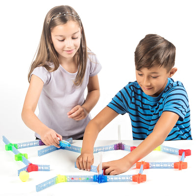 Two children playing with a brackitz educational toy bugz set