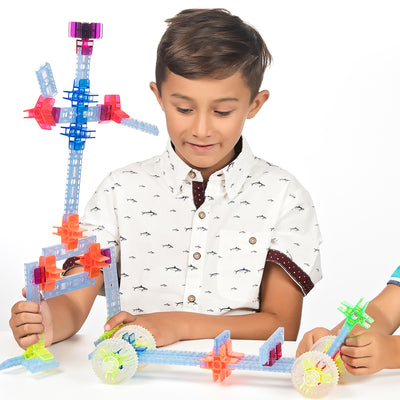 boy playing with brackitz learning toy