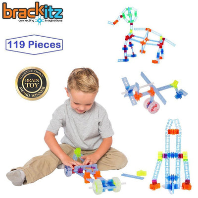 boy with three Brackitz learning toy builds