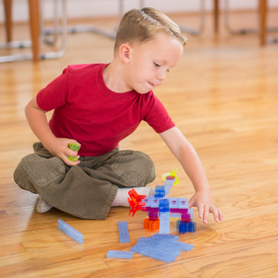 Brackitz learning toy and boy playing on the floor