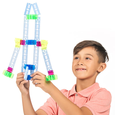boy playing with a rocket from a brackitz educational set
