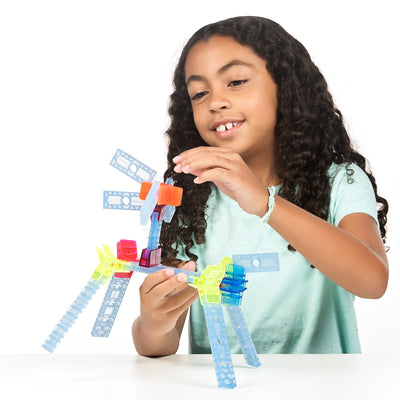 Girl playing with a brackitz learning set dog build