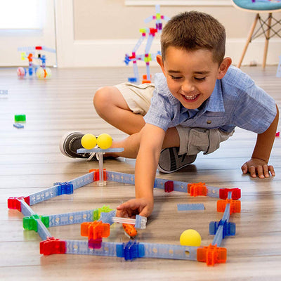 Boy playing with Brackitz Bugz learning set