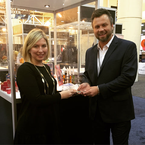 Royal Penn Products founder and president, David Andrascik accepts the top prize winning the 2016 best new products Award at the international Halloween and Party supply convention in New Orleans, LA
