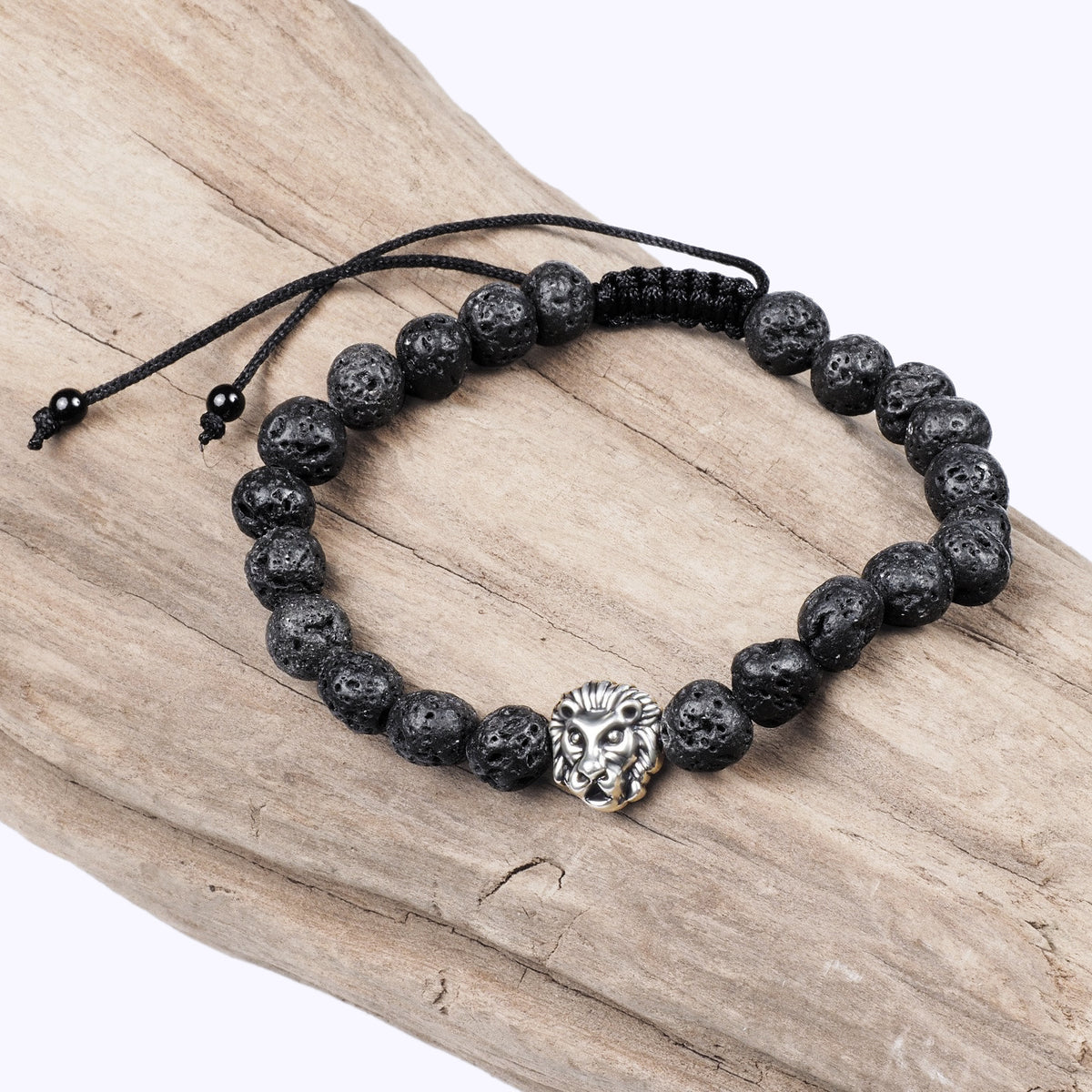 Black Adjustable Lava Bracelet with a Silver Lion Head Charm