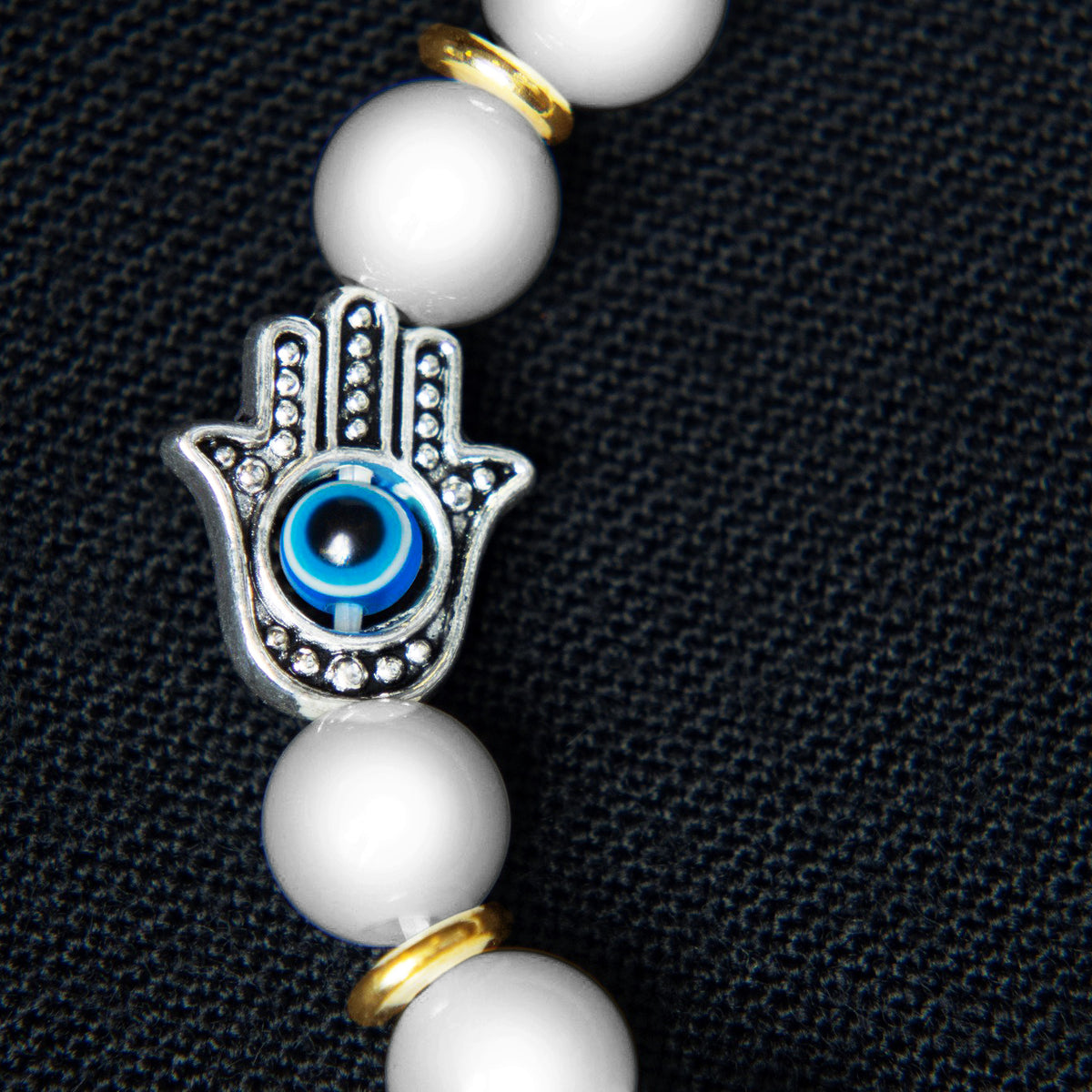 White Agate Beads with Hamsa Hand Charm Featuring Third Eye Chakra