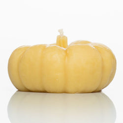 Pumpkin-shaped beeswax candle.