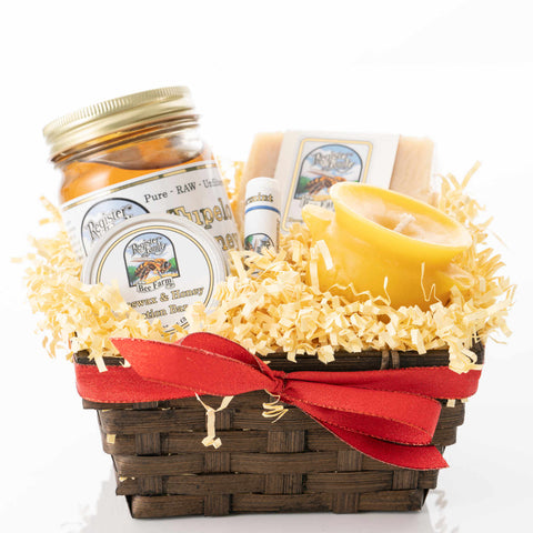 Small gift basket of honey, beeswax candles, and other beeswax products