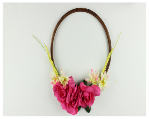 pink floral wreath made from embroidery hoops