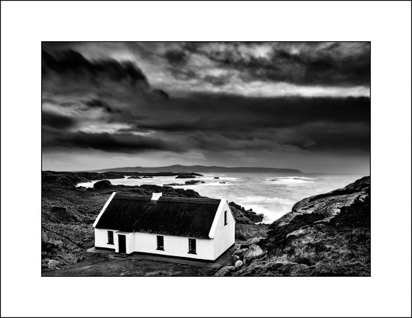 Black & white fine art landscape photography of an Irish thatched cottage on the Wild Atlantic Way in Donegal Ireland