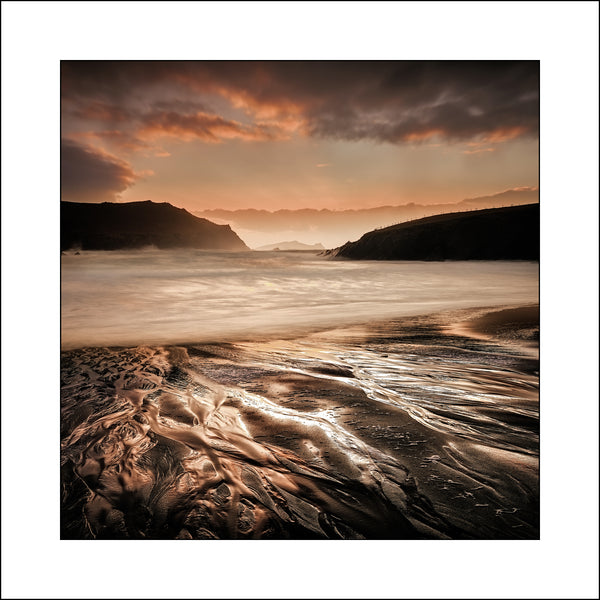Sunset at Clogher Strand Co Kerry Ireland by by Fine Art Landscape Photographer John Taggart